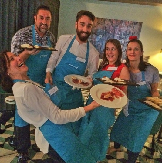 portfolio-Madrid-Convention-Bureau-Team-serving-delicious-Spanish-food-eventprofs-meetingdesign-awinkfrommadrd