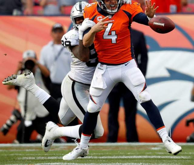 Denver Broncos Quarterback Case Keenum 4 Fumbles Under Pressure From Oakland Raiders Defensive End Arden Key 99 During The Second Half Sunday In Denver