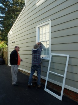 installing custom made storm window- cold spring ny