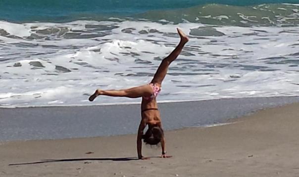 Beach girl cartwheel crop by Jenifer Joy Madden