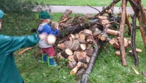 Child throws wood cookie