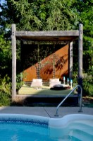 Tree silhouette Cor-ten metal screen installed on an exterior bed. Custom made by Dusil Design. Carlisle, Ontario