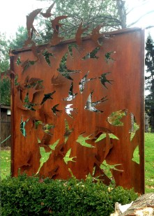 Metal screen and sculpture. These birds were CNC laser cut and welded on with spacers for a 3 dimensional effect. Rusted Cor-ten steel, Toronto, Ontario