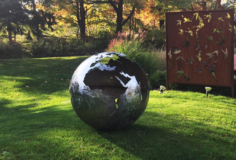 Corten Steel Globe Sculpture and Fireplace