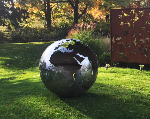 Corten Steel Globe Sculpture and Fireplace