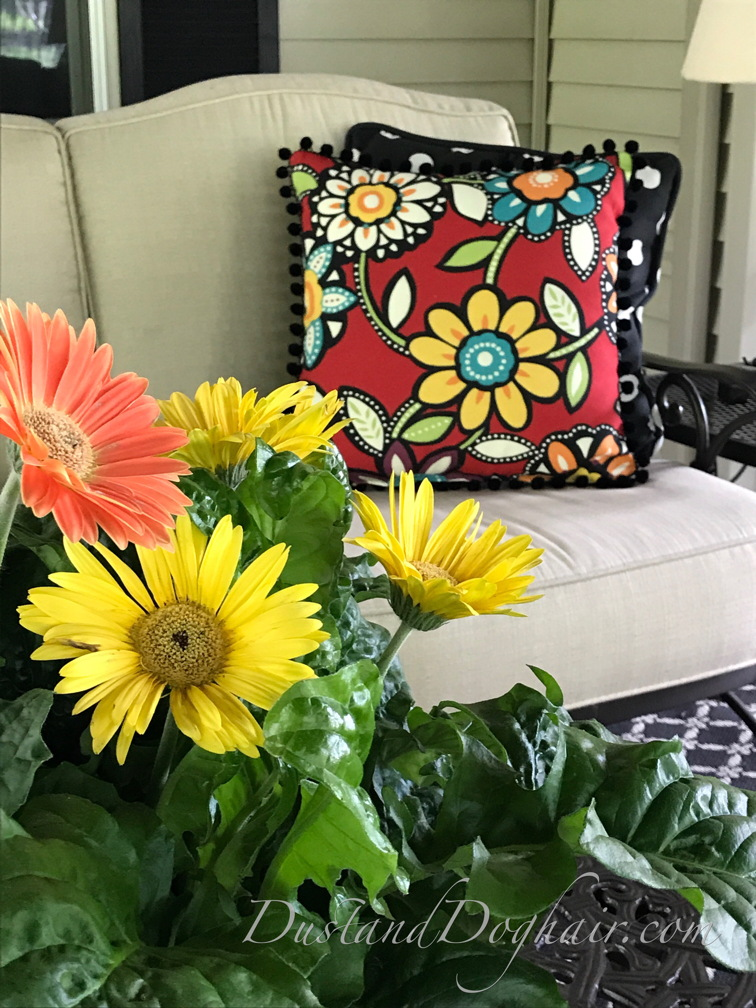 throw pillows, outdoor pillows, red pillows, floral pillows, striped pillows, ball fringe, rick rack, outdoor furniture, bold prints, bold pillows, pom pom trim, ball fringe pillows