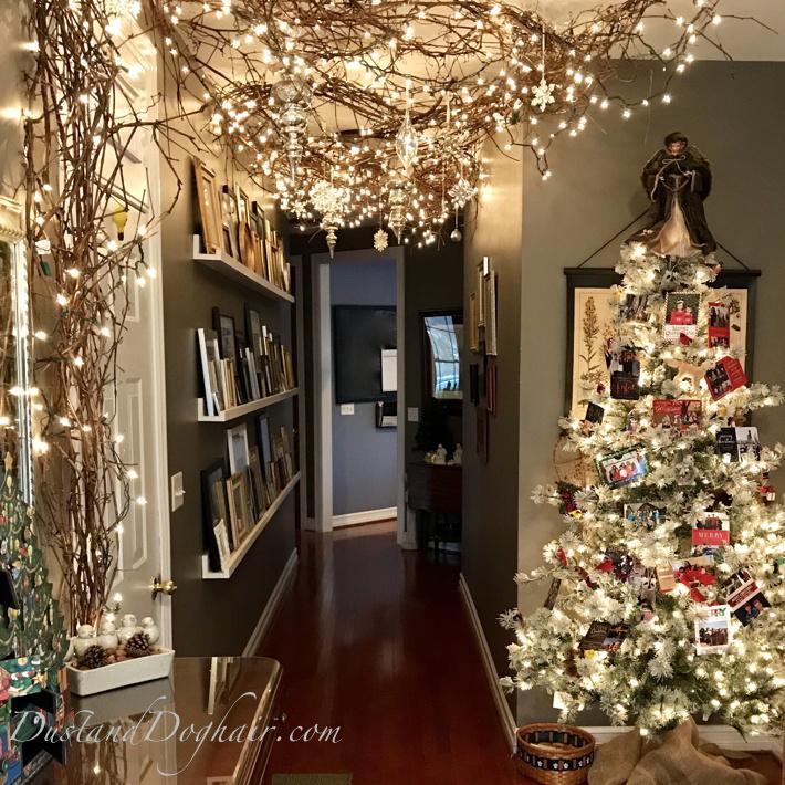 decorated hallway, christmas hallway, beautiful decorations, ceiling decorations, ceiling lights, christmas card tree, gallery wall