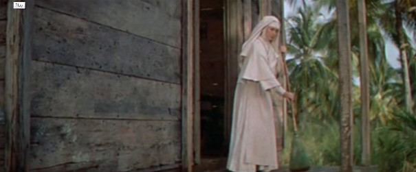 Sister Angela sweeps the church porch