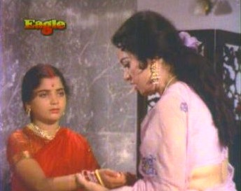 Ratna, aghast at Rupa's condition