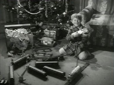 Timmy gets a toy train for Christmas