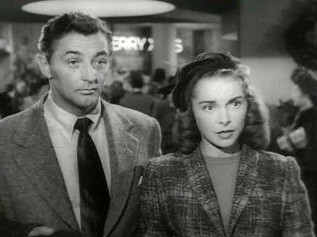 Mitchum as Steve Mason in Holiday Affair