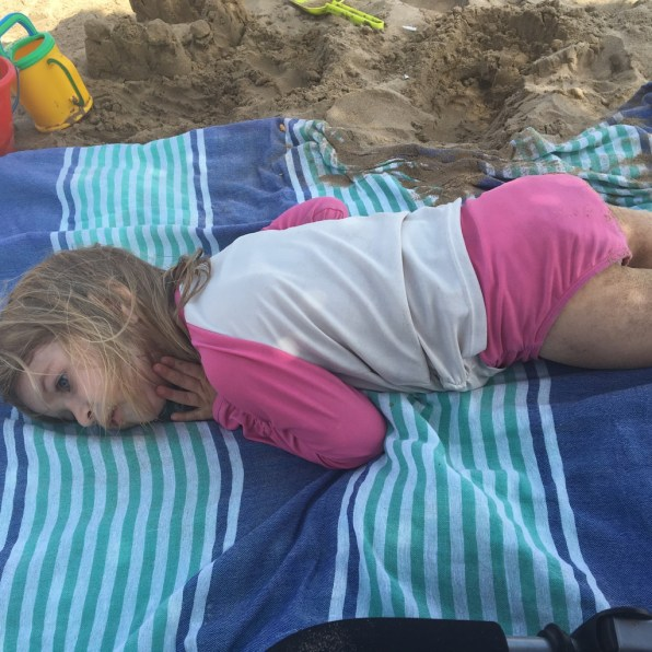Pretending she was really going to sleep on the beach