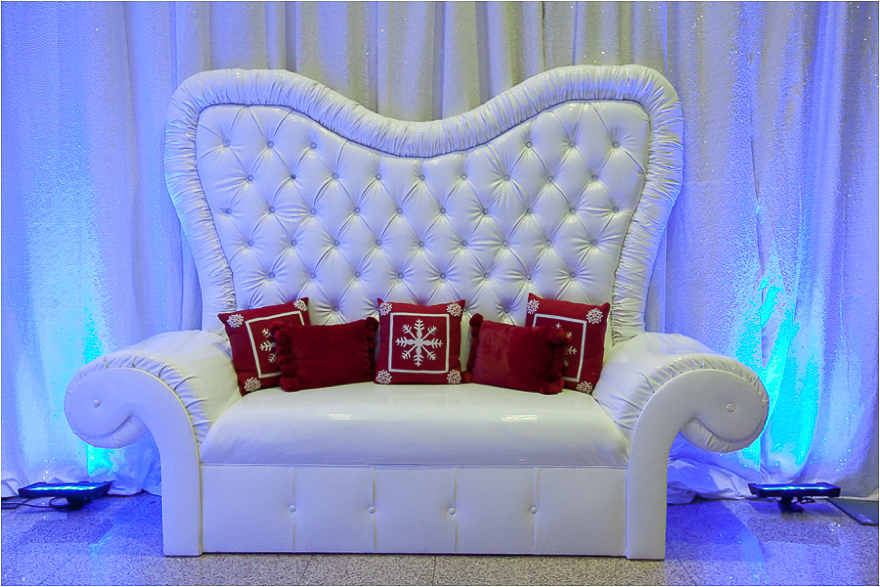 Christmas Santa Claus chair seat decor at a wedding reception held at the Texas State history Museum Opelik