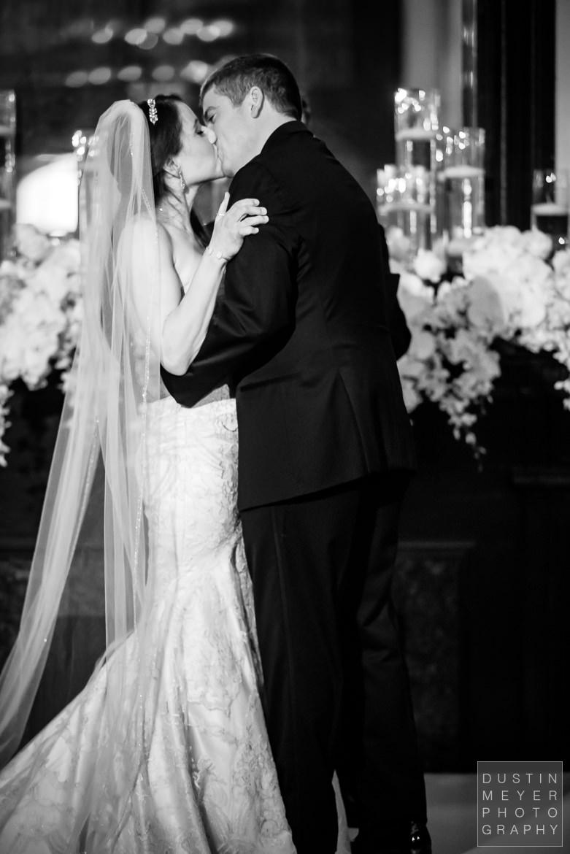 Bride and Groom Kiss at the altar   Driskill Hotel Wedding Austin Wedding Photographers