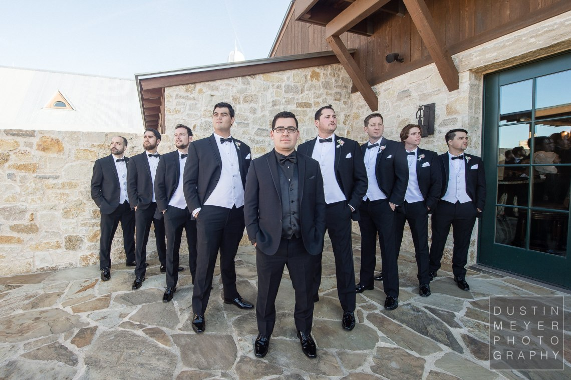 The groomsmen proudly standing by the groom