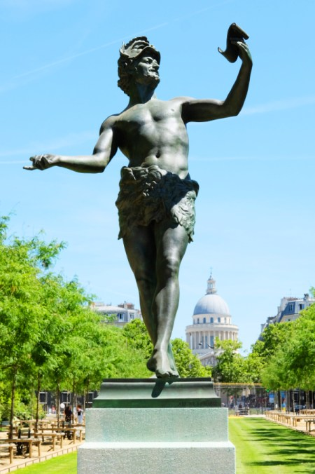 A statue of Pan in the Luxembourg Gardens with the dome of the Panthéon visible in the background.