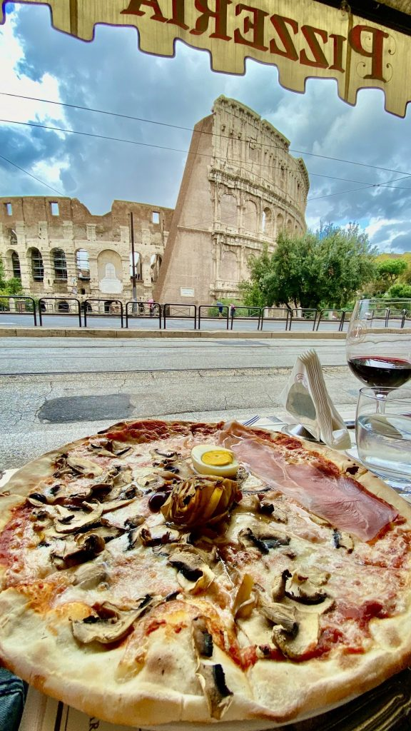 Pizza with Colosseum views.