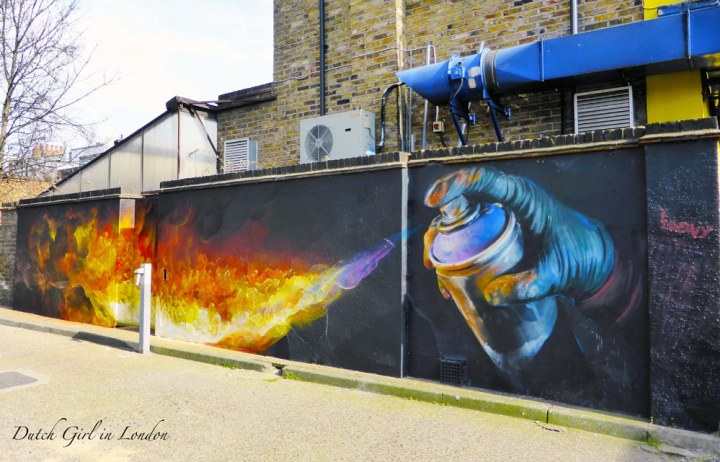 graffiti of flames coming out of a spray can