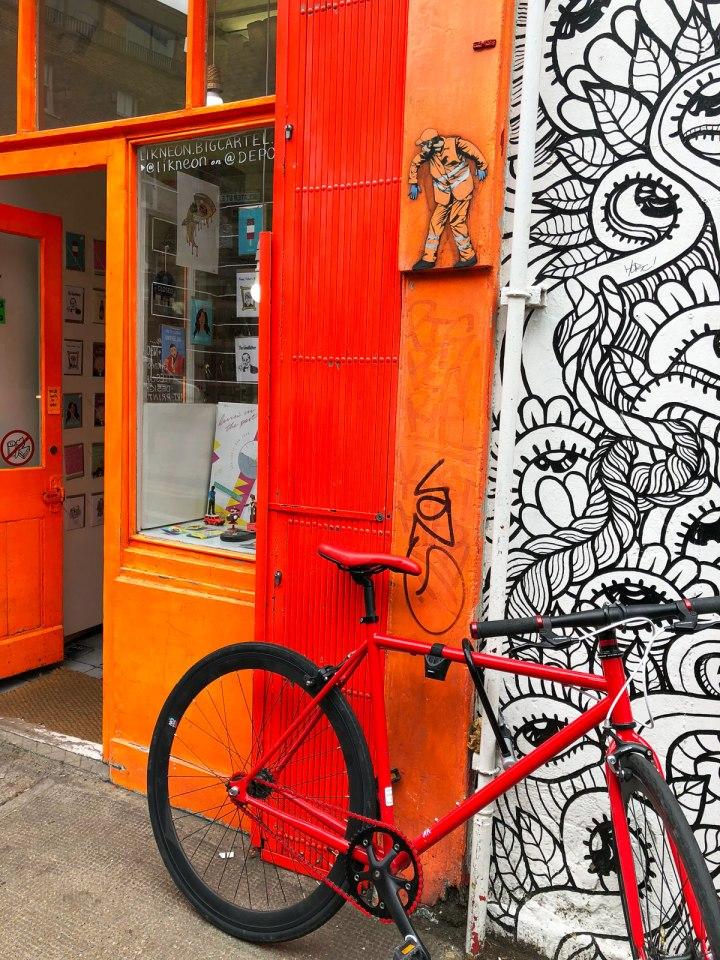 Jaune-street-art-Sclater-Street-shop-Dutch-Girl-in-London