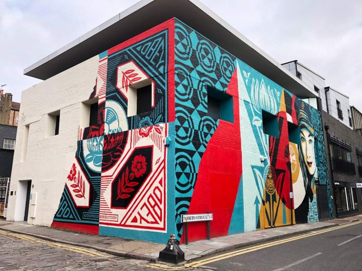 Shepard Fairey mural on two sides of a building in Shoreditch, London