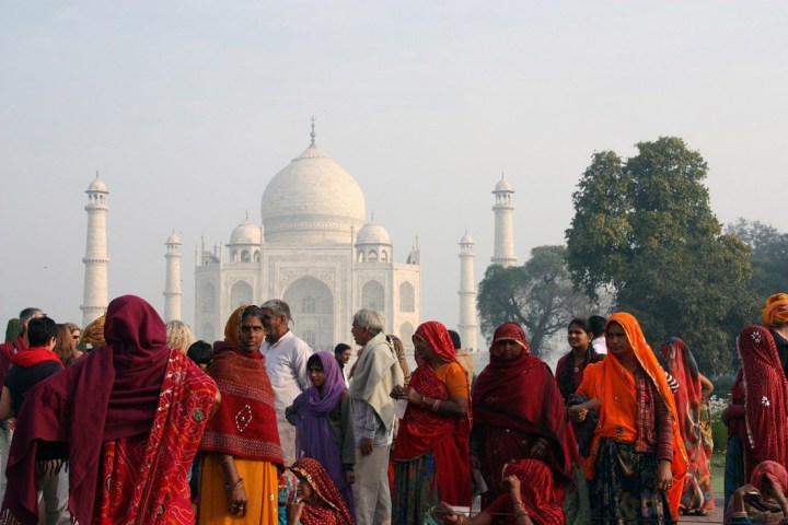 Group of Indian people in front of the Taj Mahal in India