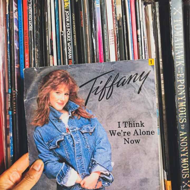 close-up of my hand holding the vinyl single record of Tiffany's I Think We'Re Alone Now