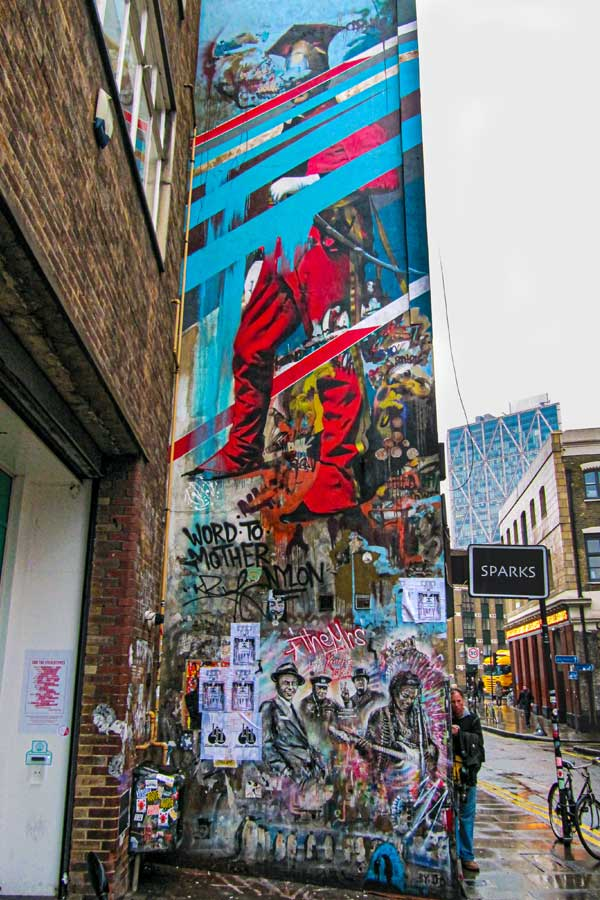 iconic mural by Conor Harrington in Shoreditch, London, of a baroque-style soldier with abstract lines across his face and body