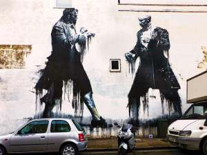 Mural of two boxers dressed in 17th-century clothing by Conor Harrington part of the Dulwich Outdoor Gallery