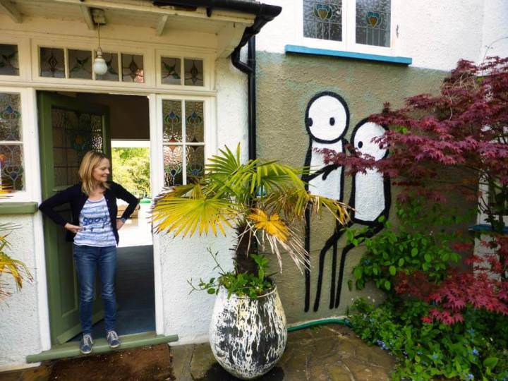 Ingrid Beazly, founder of Dulwich Outdoor Gallery, looking at the Stik mural by her front door