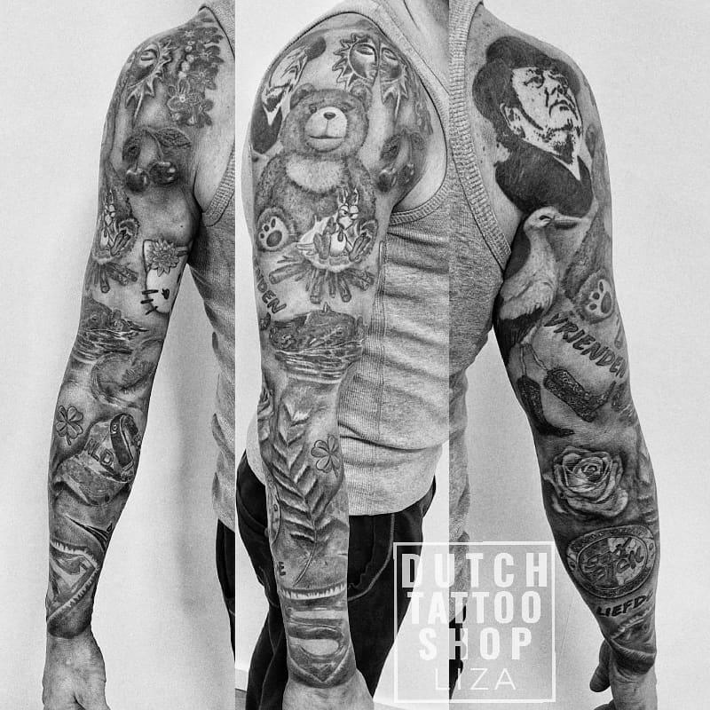 tattoo-sleeve-diverse-andre-hazes-ooievaar-hello-kitty-nijlpaard-superman-lippen-zwart-grijs