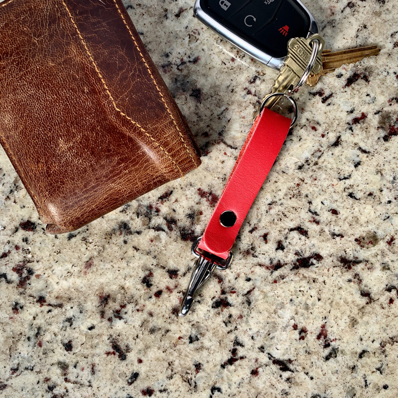 Coral color key fob made from leather for holding your keys