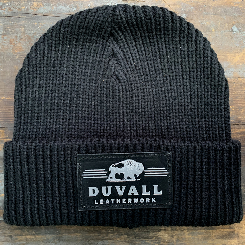 a warm knit cap with Duvall Leatherwork patch