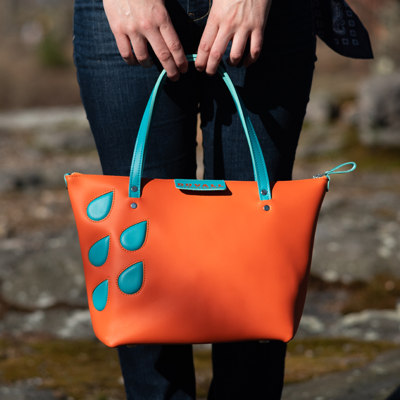 Model holding a Duvall Leatherwork handbag