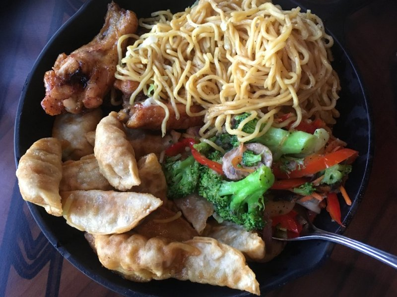 Wings, potstickers, noodles, and vegetables.