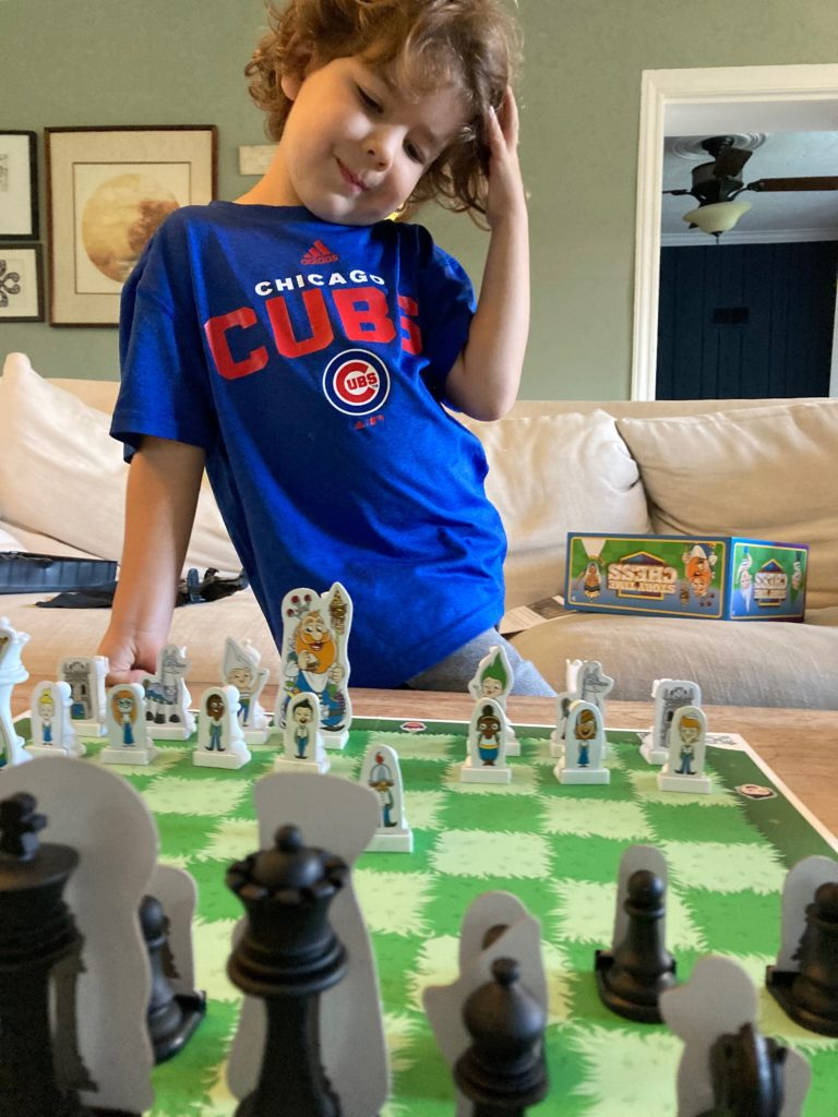 kid playing chess