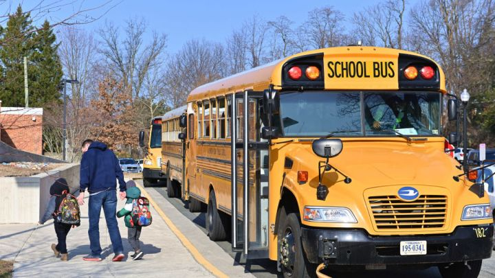 ARLINGTON, VA - MARCH 04: A school bus arrives at Ashlawn elementary school on March 4, 2021 in Arlington, VA. Ashlawn elementary school reopens on Thursday in Arlington.