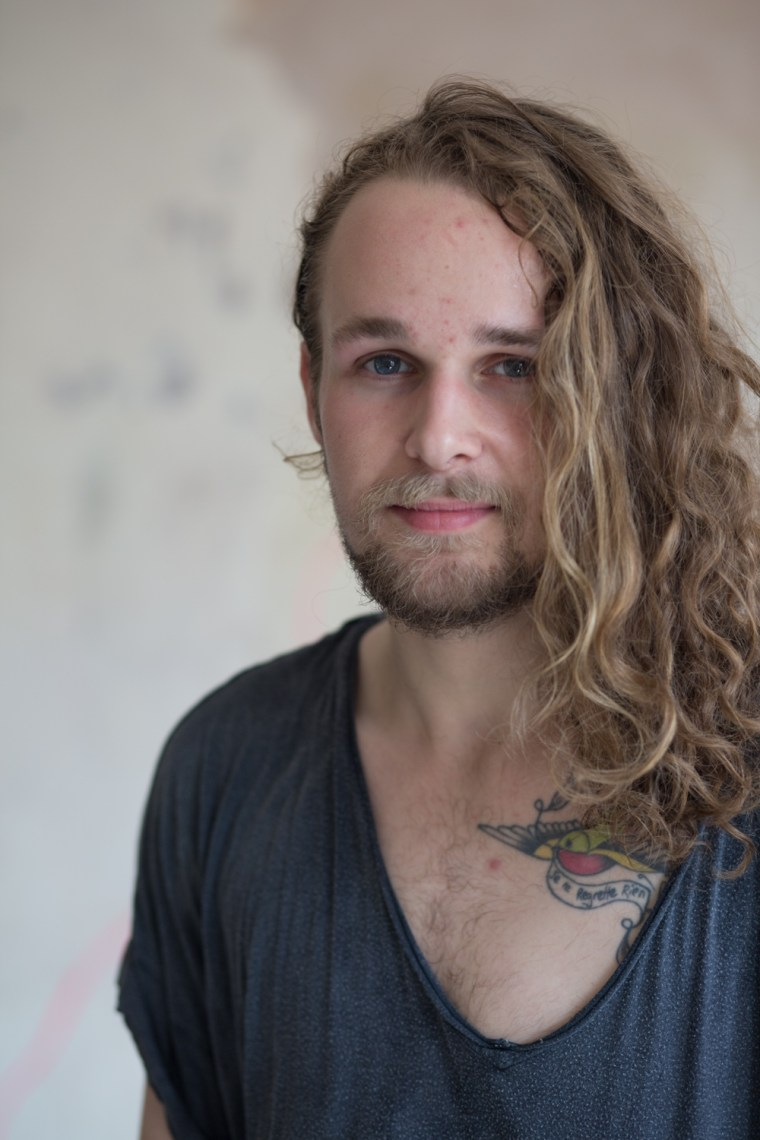 Joey Mottershead colour portrait long hair man natural light empty space old building
