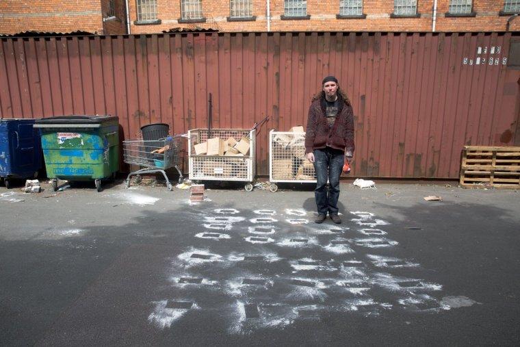 Matt Smith stands before an array of flour imprints