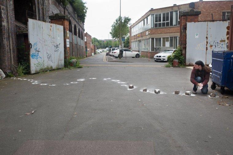 A long line of flour imprints left by absent bricks