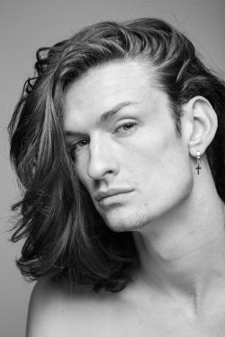 Black and white headshot of performer Daniel Sykes in Leicester studio