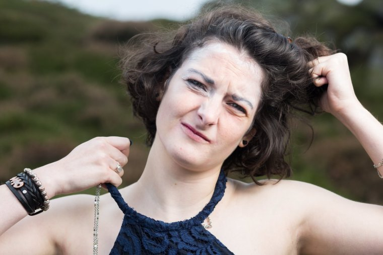 Emma Chatel with most of her makeup removed, tears her hair and dress