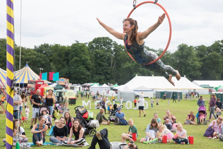 A performer from Circus Hub Nottingham on aerial lyre at Gloworm Festival