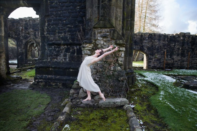 Aimee Lily Williamson dancing in the grounds of Whalley Abbey