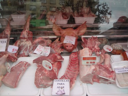 Scenes from the markets of Pamplona. Never seen a pigs head in a market before.