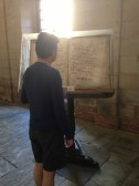 Dom reading from an old book inside the Cathedral.
