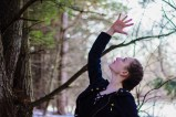 Dancer poses dramatically in woods
