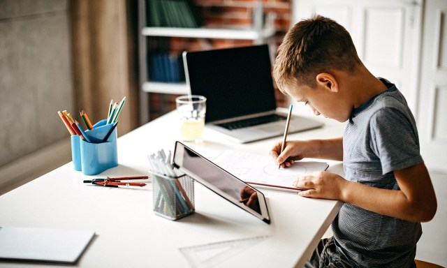 A child using a tablet at home