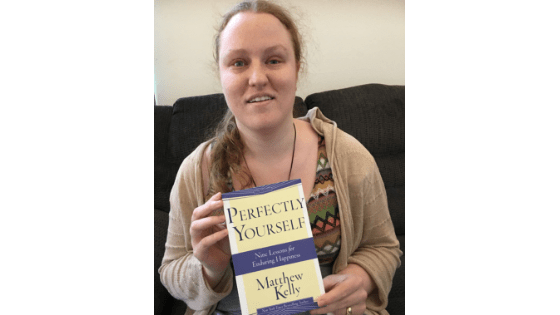 """Katie Corbett holds the book """"Perfectly Yourself"""""""
