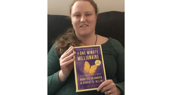 "Katie Corbett holds the book, ""One Minute Millionaire"""