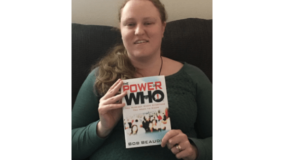"""Katie Corbett holds the book, """"The Power of Who"""""""